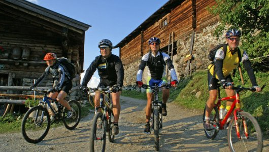 Group of bikers at decline from Farmkehralm in Inneralpbach