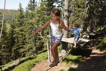 Girl at rope garden in Lauserland