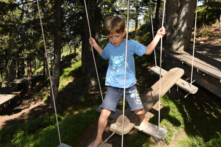 Boy in the rope garden in Lauserland