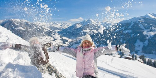 A girl playing in the Snow in Alpbach