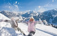 Children playing in the snow in Alpbachtal