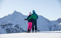 skiing couple view