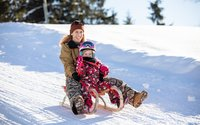 Familienrodeln am Reither Kogel | © Alpbachtal Seenland Tourismus | shoot+style